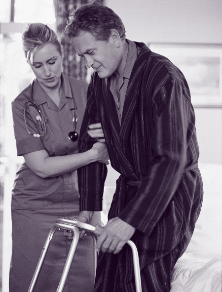 Certified Nursing Assistant helping Patient
